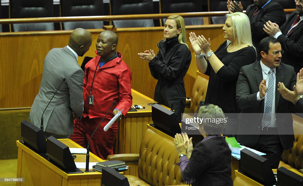 Democratic Alliance leader Mmusi Maimane has a word with Economic Freedom Fighters leader Julius Malema during Parliaments post municipal elections...
