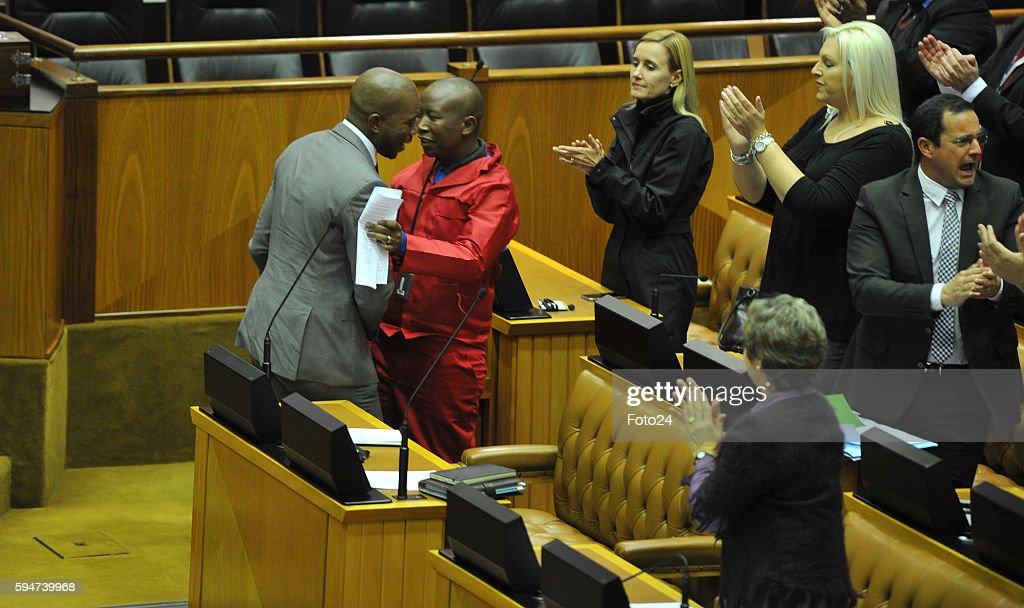Democratic Alliance leader Mmusi Maimane hugs Economic Freedom Fighters leader Julius Malema during Parliaments post municipal elections debate on...