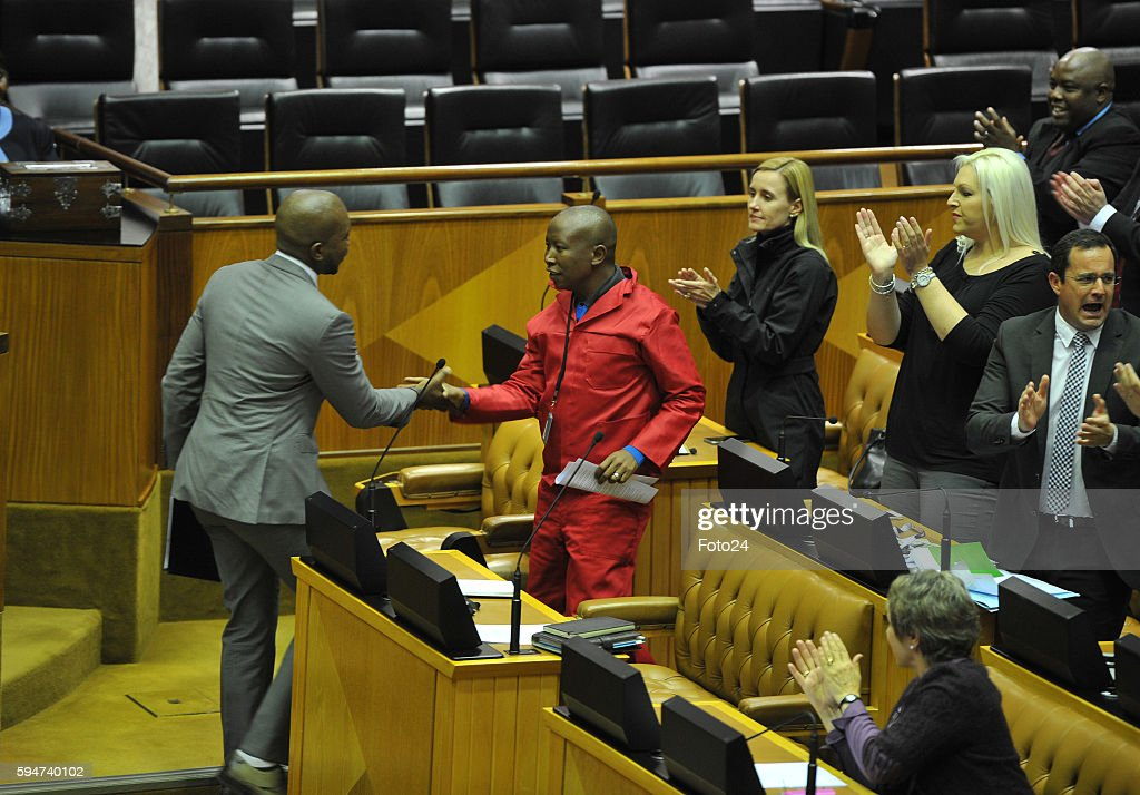Democratic Alliance leader Mmusi Maimane shakes hands with Economic Freedom Fighters leader Julius Malema during Parliaments post municipal elections...