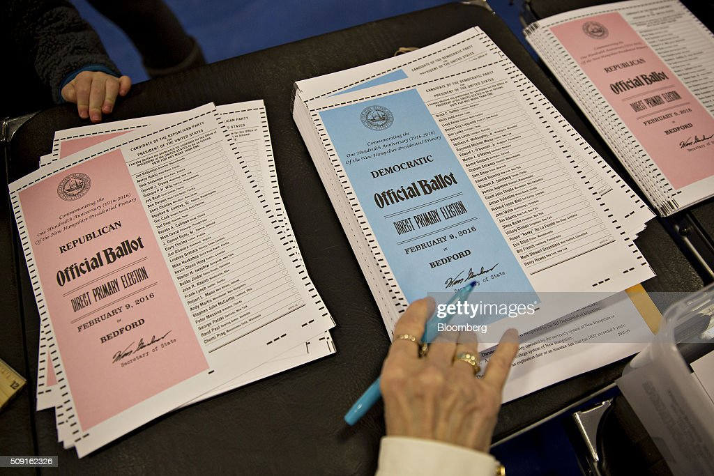 Democratic and Republican ballots sit on a sign-in table at a polling station in Bedford, New Hampshire, U.S., on Tuesday, Feb. 9, 2016. Voters in New Hampshire took to the polls today in the nations first primary in the U.S. presidential race. Photographer: Daniel Acker/Bloomberg via Getty Images