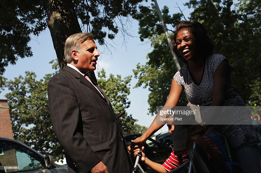 Democratic Assemblyman <a gi-track='captionPersonalityLinkClicked' href=/galleries/search?phrase=David+Weprin&family=editorial&specificpeople=5922077 ng-click='$event.stopPropagation()'>David Weprin</a>, who is running for Congress in a race in New York's heavily Democratic 9th District, speaks with a voter at a polling station on September 13, 2011 in the Queens borough of New York City. Weprin is running against Republican Bob Turner to succeed Democrat Anthony Weiner who resigned in June after admitting he sent partially nude photos of himself to women via the Internet. The race has received strong media attention as it is being viewed as a bellwether of support for President Barack Obama and Washington.