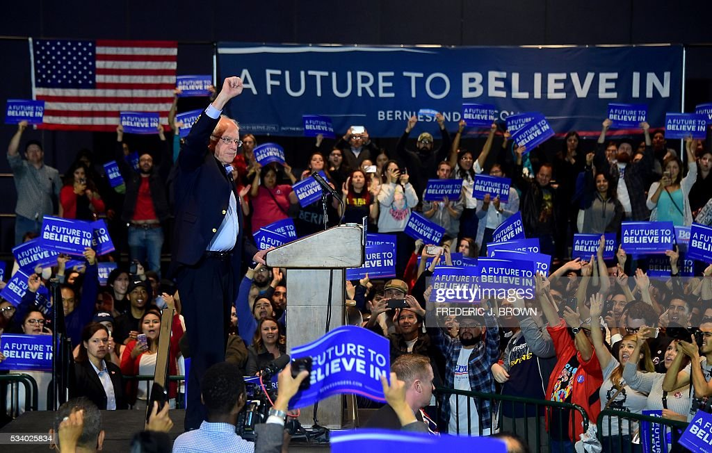 Democratic candidate Bernie Sanders gestures following his speech to supporters at a rally in Anaheim, California on May 24, 2016, ahead of the June 7th California primary vote. / AFP / FREDERIC