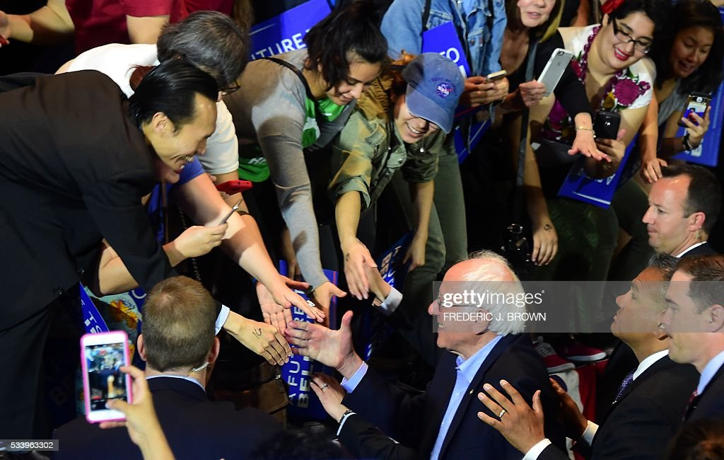 Democratic candidate Bernie Sanders greets supporters after speaking at a rally in Anaheim, California on May 24, 2016. / AFP / FREDERIC