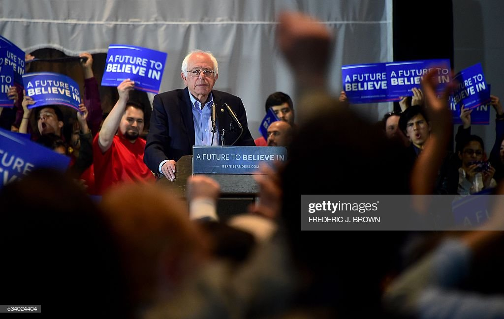 Democratic candidate Bernie Sanders watches as supporters react to his speech at a rally in Anaheim, California on May 24, 2016, ahead of the June 7th California primary. / AFP / FREDERIC