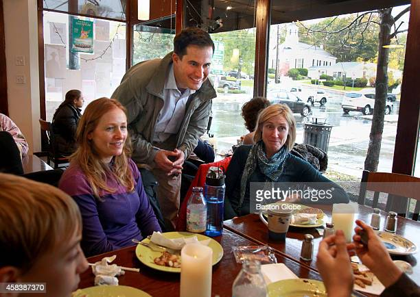 Democratic candidate for congress Seth Moulton campaigns before taking a lunch break at the Five Corners Cafe Deli in Ipswich Mass on November 1 2014...