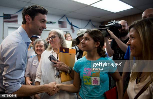 Democratic candidate for Georgia's 6th Congressional district Jon Ossoff shakes hands with campaign workers and volunteers at his campaign office in...