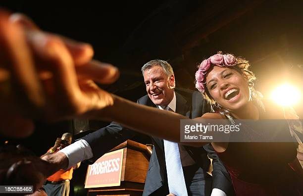 Democratic candidate for Mayor Bill de Blasio and daughter Chiara celebrate at his primary night party on September 11 2013 in the Brooklyn borough...