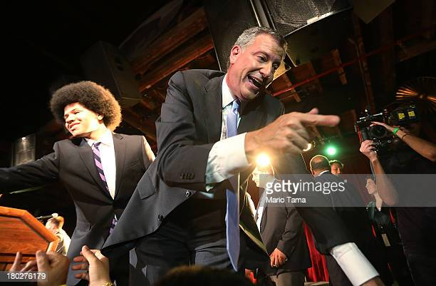 Democratic candidate for Mayor Bill de Blasio greets well wishers with his son Dante at his primary night party on September 11 2013 in the Brooklyn...