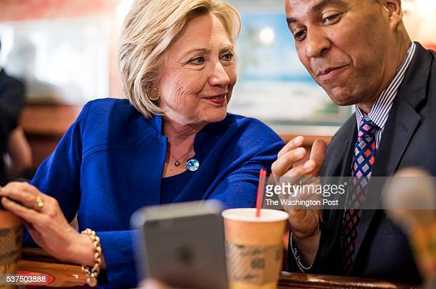 NEWARK NJ Democratic Candidate for President former Secretary of State Hillary Clinton and Senator Cory Booker orders and enjoys Cuban coffee at...