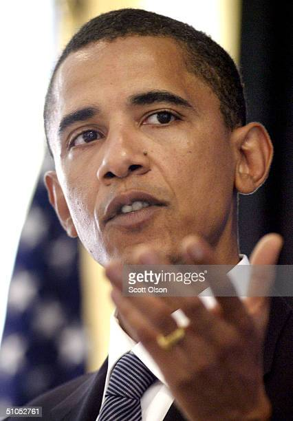 Democratic candidate for US Senate Barack Obama gestures as he speaks to members of the Chicago Council on Foreign Relations July 12 2004 in Chicago...