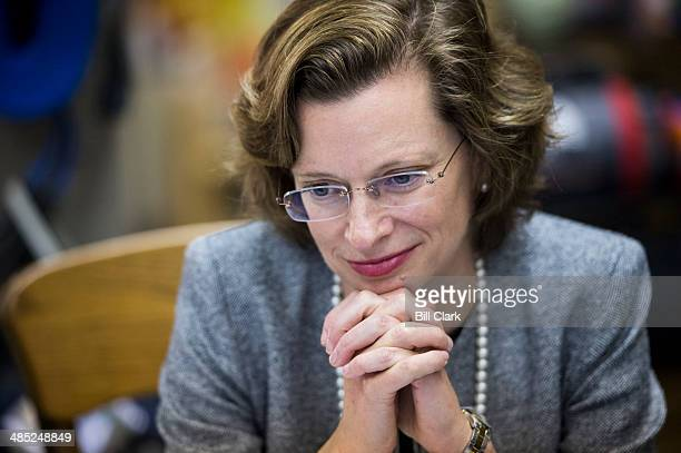 Democratic candidate for US Senate Michelle Nunn listens during her tour of the Whitewater Express rafting business by the Chattahoochee River in...