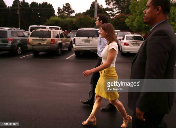 Democratic candidate Jon Ossoff and his fiancee Alisha Kramer walk to their vehicle after holding a rally to thank volunteers and supporters on the...