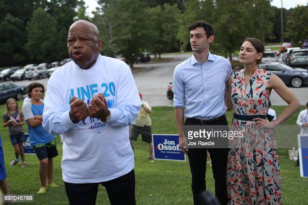 Democratic candidate Jon Ossoff and his girlfriend Alisha Kramer listen as Rep John Lewis endorses him during a meet and greet with voters at a...