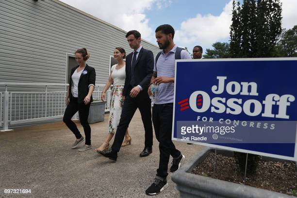 Democratic candidate Jon Ossoff and his girlfriend Alisha Kramer walk with staff members after thanking volunteers and supporters at a campaign...