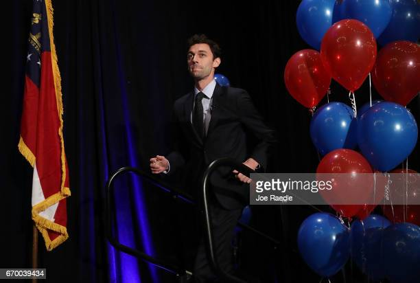 Democratic candidate Jon Ossoff arrives on stage to speak to his supporters as votes continue to be counted in a race that was too close to call for...