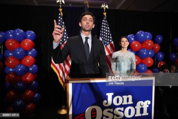Democratic candidate Jon Ossoff delivers a concession speech as his fiancee Alisha Kramer listens during his election night party being held at the...