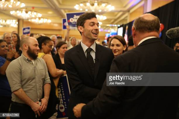 Democratic candidate Jon Ossoff greets people after speaking to his supporters as votes continue to be counted in a race that was too close to call...