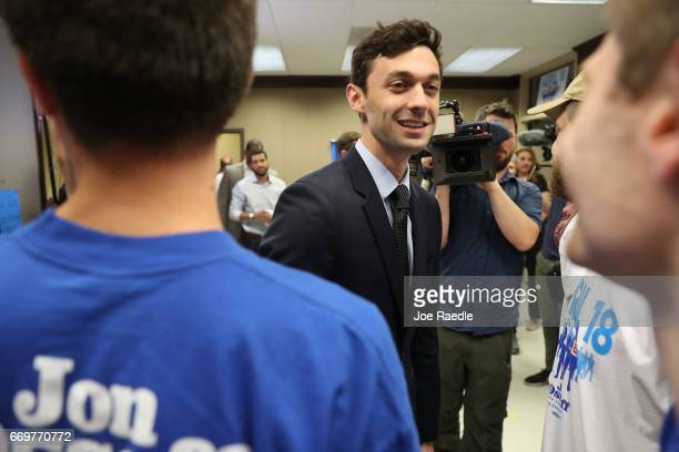 Democratic candidate Jon Ossoff greets volunteers and supporters at a campaign office during an election day kickoff rally as he runs for Georgia's...