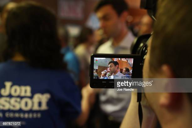 Democratic candidate Jon Ossoff is seen on a camcorder as he greets people during a visit to a campaign office to thank volunteers and supporters as...