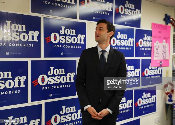 Democratic candidate Jon Ossoff speaks with volunteers and supporters in a campaign office on Election Day as he runs for Georgia's 6th Congressional...