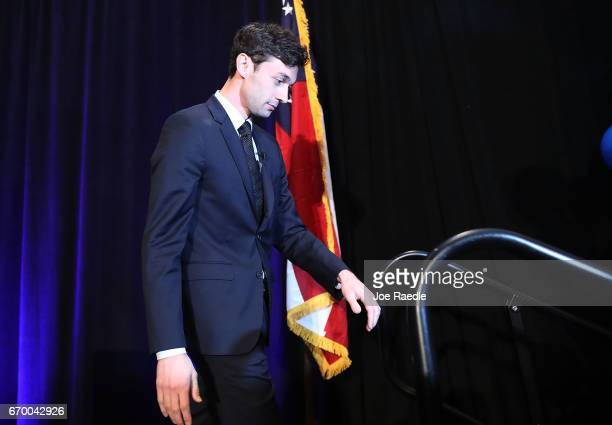 Democratic candidate Jon Ossoff walks off stage stage after speaking to his supporters as votes continue to be counted in a race that was too close...