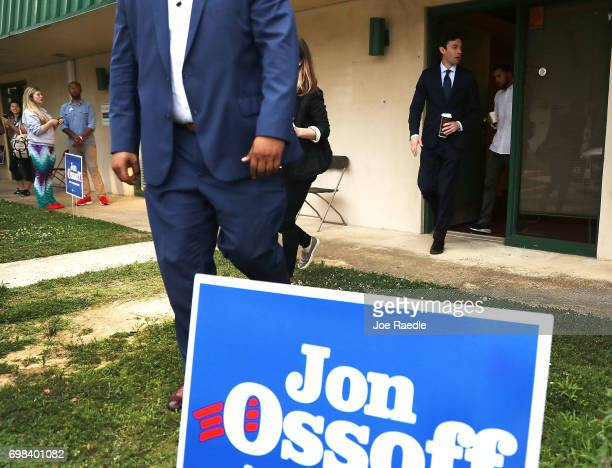 Democratic candidate Jon Ossoff walks out of a campaign office after speaking with volunteers and supporters on Election Day as he runs for Georgia's...