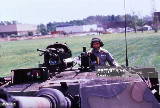 Democratic candidate Michael Dukakis riding on M1A tank in General Dynamics plant during presidential campaign
