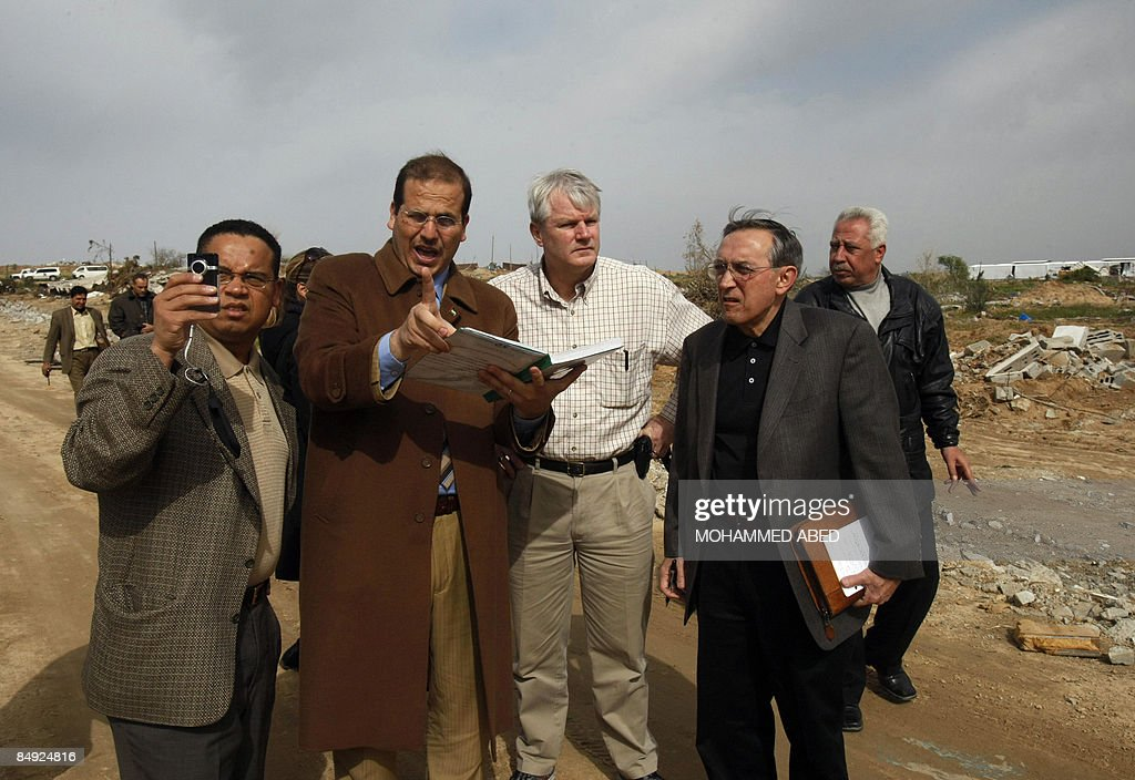 US Democratic Congressmen Keith Ellison and Brian Baird and senior policy advisor Nicholas Palarino listen to a Palestinian owner of a company that...