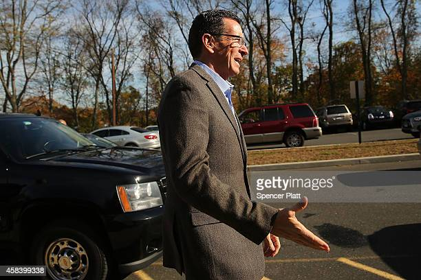 Democratic Connecticut Governor Dan Malloy stops at a polling station on November 4 2014 in Bridgeport Connecticut Around the country voters are...