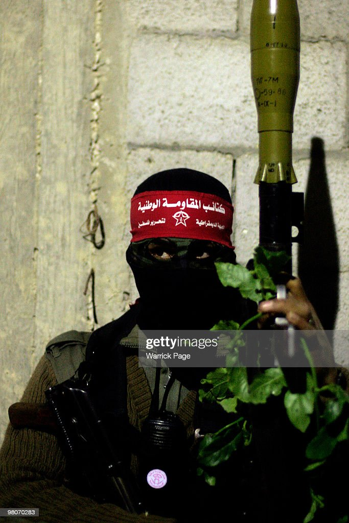 Democratic Front for the Liberation of Palestine militant poses for a photograph while on post early Friday morning March 26 2010 in Zeyton Gaza...