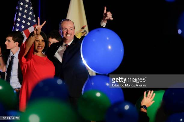 Democratic Govelect Phil Murphy and his running mate Lt Govelect Sheila Oliver celebrate during an election night rally on November 7 2017 in Asbury...