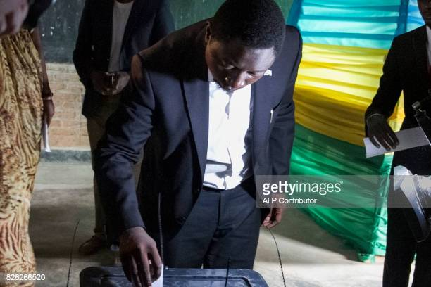Democratic Green Party's candidate Frank Habineza casts his ballot at a polling station in Kigali on August 4 2017 as the polls opened for the...
