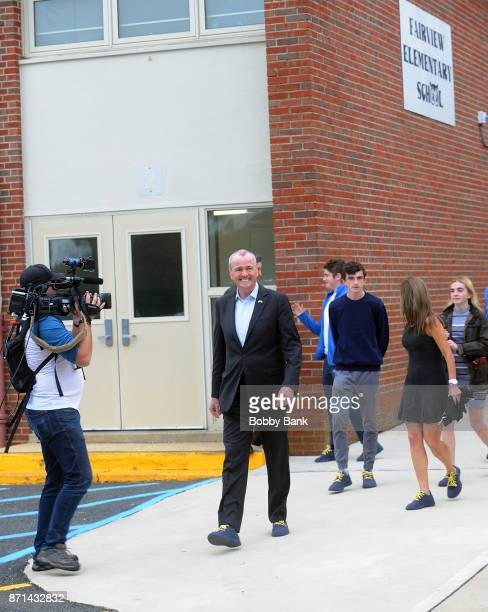 Democratic gubernatorial candidate Phil Murphy and his family leaves after voting on election day November 7 2017 in Asbury Park New Jersey Murphy...