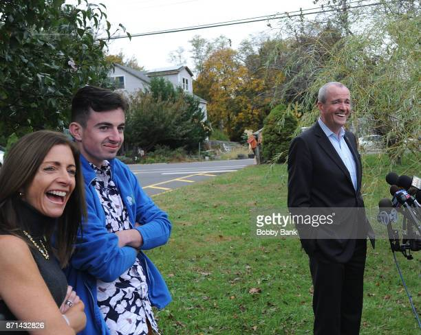 Democratic gubernatorial candidate Phil Murphy attends a news conference with wife Tammy Murphy and son Josh after voting on election day November 7...