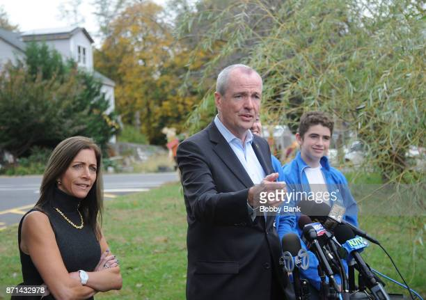 Democratic gubernatorial candidate Phil Murphy attends a news conference with wife Tammy Murphy and son Sam after voting on election day November 7...