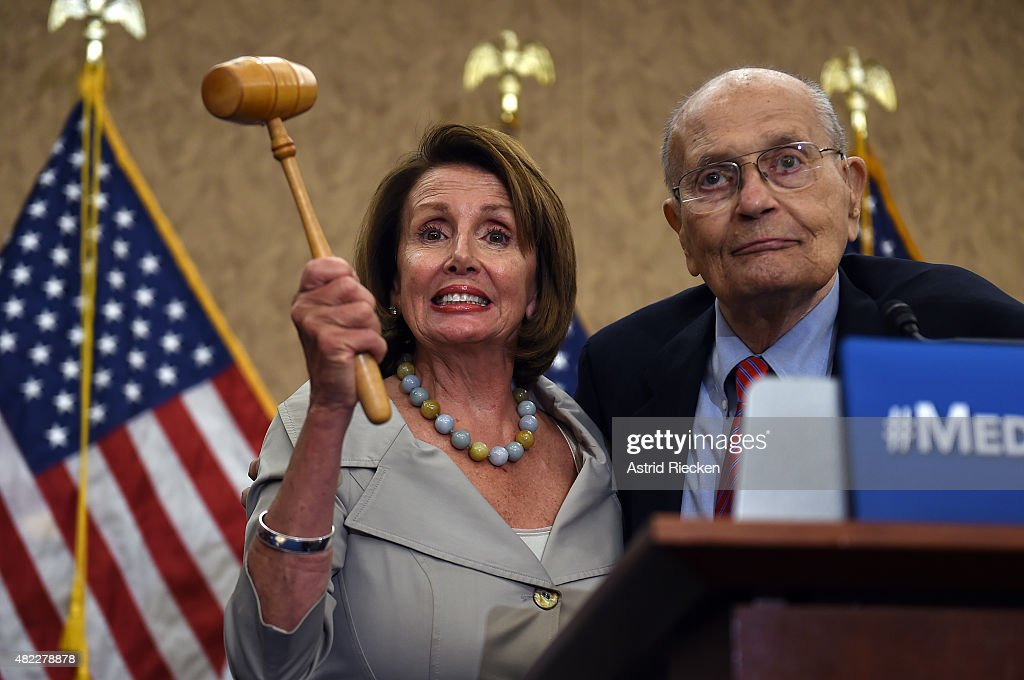 Democratic House Leader Nancy Pelosi, accompanied by former congressman John Dingell, marks the 50th Anniversary of Medicare and Medicaid on Capitol Hill on July 29, 2015 in Washington, DC. Pelosi was joined by Senate and House lawmakers who oppose any cuts to the important program for seniors.