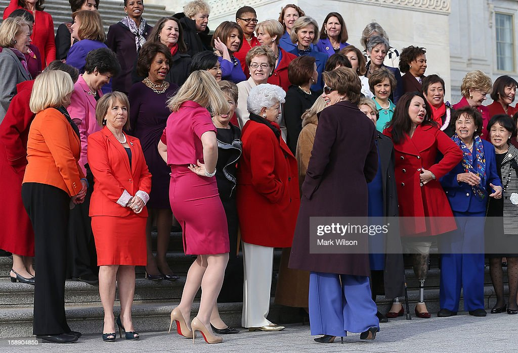 Democratic Leader <a gi-track='captionPersonalityLinkClicked' href=/galleries/search?phrase=Nancy+Pelosi&family=editorial&specificpeople=169883 ng-click='$event.stopPropagation()'>Nancy Pelosi</a> (D-CA) (6th L), stands with the Democratic women of the House Democratic Caucus during a photo op on January 3, 2013 in Washington, DC. The new 113th Congress will be sworn in today.