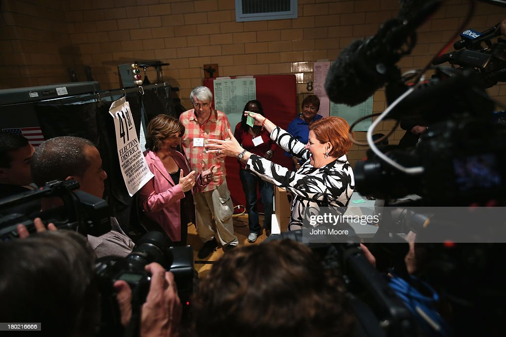 Democratic mayoral candidate <a gi-track='captionPersonalityLinkClicked' href=/galleries/search?phrase=Christine+Quinn&family=editorial&specificpeople=550180 ng-click='$event.stopPropagation()'>Christine Quinn</a> (R) and her wife Kim Catullo embrace after casting their votes in the primary election for New York City mayor on September 10, 2013 in New York City. Quinn, trailing in the polls, is hoping to garner enough votes to compete in a runoff election to be the Democratic candidate.