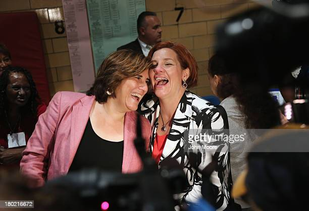 Democratic mayoral candidate Christine Quinn and her wife Kim Catullo embrace before casting their votes in the primary election for New York City...