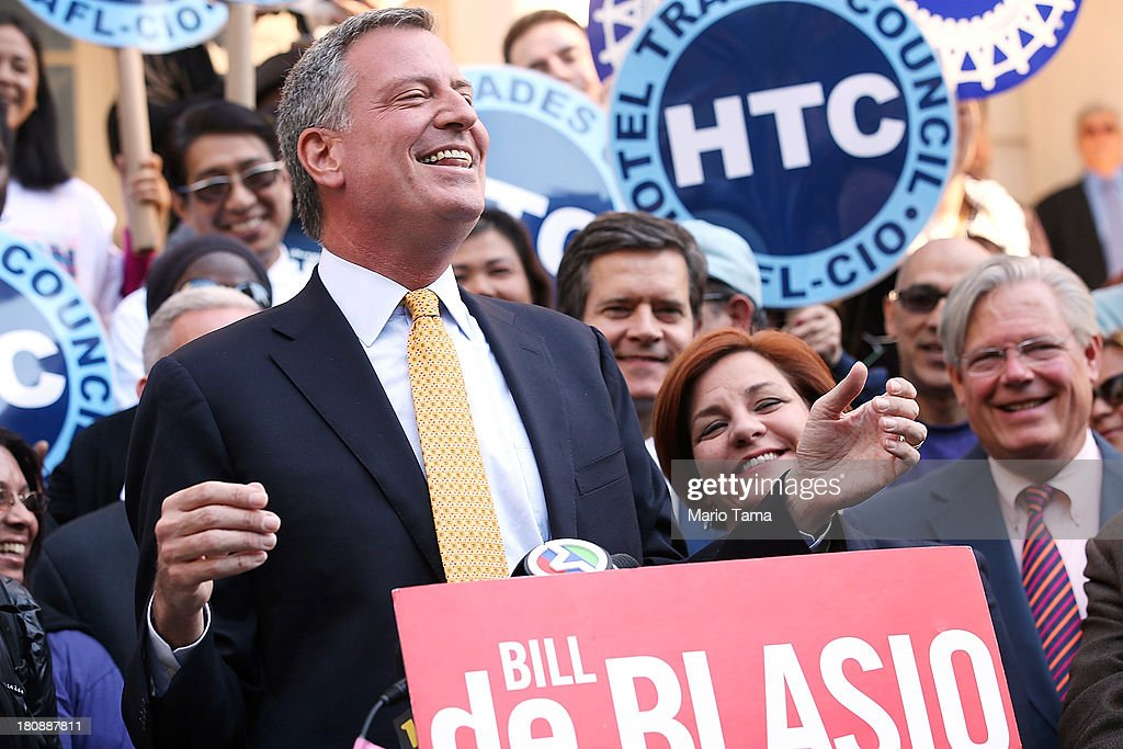 Democratic mayoral nominee <a gi-track='captionPersonalityLinkClicked' href=/galleries/search?phrase=Bill+de+Blasio&family=editorial&specificpeople=6224514 ng-click='$event.stopPropagation()'>Bill de Blasio</a> (L) laughs with <a gi-track='captionPersonalityLinkClicked' href=/galleries/search?phrase=Christine+Quinn&family=editorial&specificpeople=550180 ng-click='$event.stopPropagation()'>Christine Quinn</a> (2nd R), New York City Council Speaker and former mayoral hopeful, at a news conference where Quinn endorsed de Blasio outside City Hall on September 17, 2013 in New York City. De Blasio will face Republican Joseph Lhota in the general mayoral election November 5, 2013, with the winner succeeding current Mayor Michael Bloomberg.