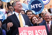 Democratic mayoral nominee Bill de Blasio laughs with Christine Quinn New York City Council Speaker and former mayoral hopeful at a news conference...