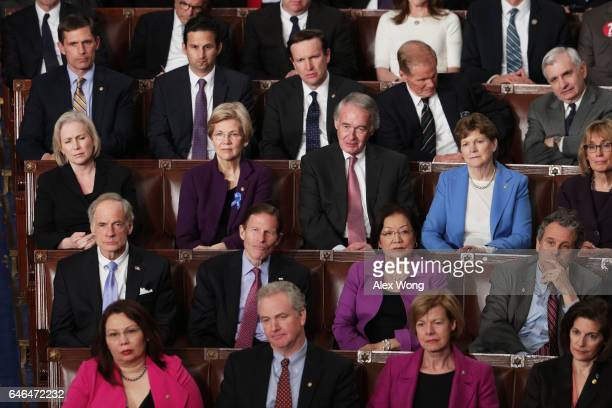 Democratic members of congress attend US President Donald Trump's address to a joint session of the US Congress on February 28 2017 in the House...