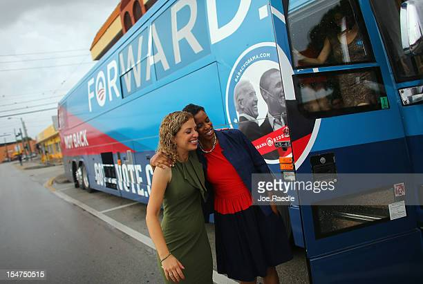 Democratic National Committee Chair Debbie Wasserman Schultz and Rep Donna Edwards hug as they exit the Democratic National Committee and Obama for...