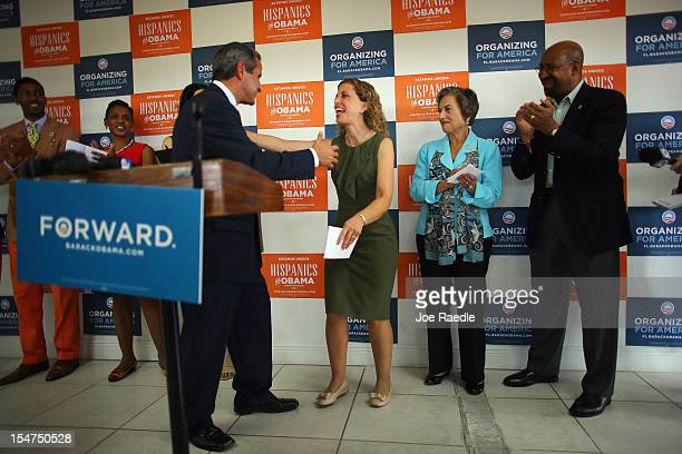 Democratic National Committee Chair Debbie Wasserman Schultz is greeted by former Mayor of Miami Manny Diaz as he introduces her to speak during a...