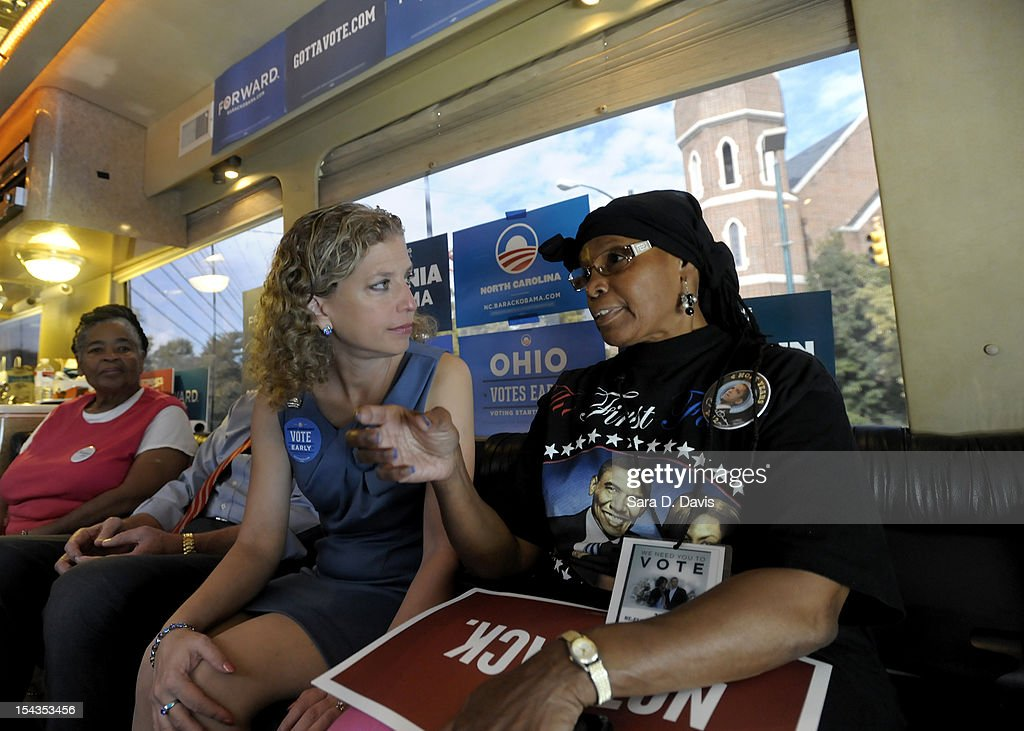 Democratic National Committee Chair Debbie Wasserman (left) talks with Najiyyah Aleem, 65 of Wilson, as they ride the Democratic National Committee and Obama for America ÒGotta VoteÓ Bus to a polling precinct for the first day of early voting on October 18, 2012 in Wilson, North Carolina. The DNC/OFA Bus is on a month long tour spending through the end of the week in North Carolina. Today is the first day to vote for the election in North Carolina. Early voting is offered at select location from now through November 3.