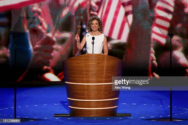 Democratic National Committee Chair US Rep Debbie Wasserman Schultz brings the convention to order as she bangs the gavel during day one of the...