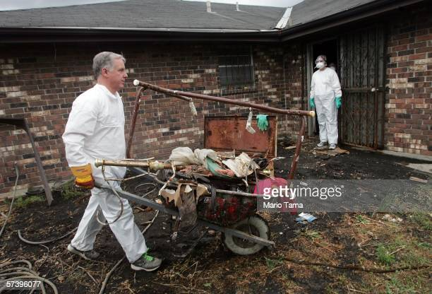 Democratic National Committee Chairman Howard Dean helps clean a damaged house in the Ninth Ward April 21 2006 in New Orleans Louisiana Dean is in...