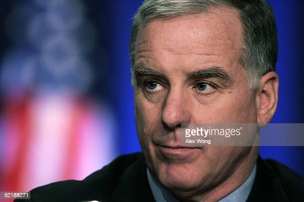 Democratic National Committee Chairman Howard Dean pauses as he chairs the last session of the DNC Winter Meeting at Washington Hilton February 12...