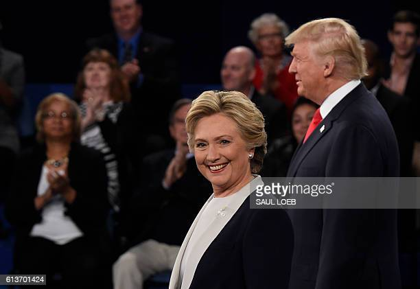 Democratic nominee Hillary Clinton and Republican nominee Donald Trump stand in front of the audience during the second presidential debate at...