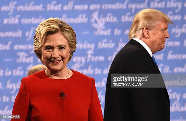 TOPSHOT Democratic nominee Hillary Clinton and Republican nominee Donald Trump leave the stage after the first presidential debate at Hofstra...
